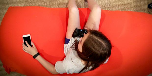 Katherine Pommerening plays Xbox in the basement. Photo / Victoria Milko