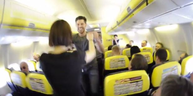 The group started dancing in the aisle of the Boeing 737-800. Photo / Golden Swing Society