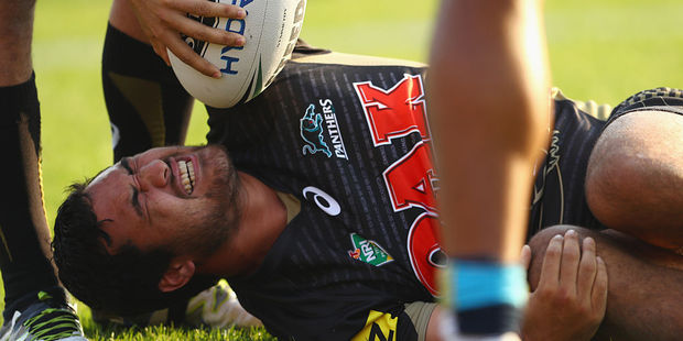 Peta Hiku of the Panthers grimaces as he lies on the ground with an injury. Photo / Getty