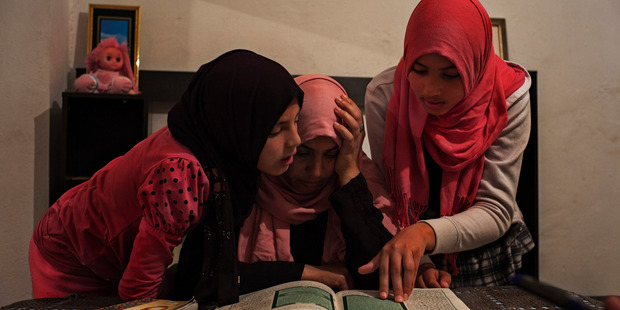 Olfa Rahmouni with her daughters Taysir, 11 and Aya, 13. Her older daughters Rahma, 17, and Ghofran, 18, joined Isis and were later captured by a Libyan militia. Photo / Washington Post