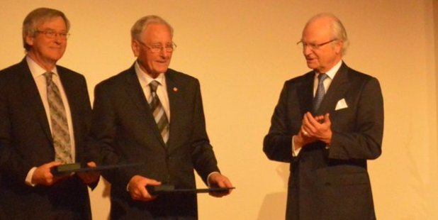Roy Kerr, centre, along with Professor Roger Blandford of Stanford University, receive the Crafoord Prize from the King of Sweden, HM King Carl XVI Gustaf, right.  Photo / Laura Pishief