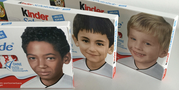 Packages of a popular chocolate bar with childhood pictures of German national players, from left, Jerome Boateng, Ilkay Gundogan and Polish born Lukas Podolski.
