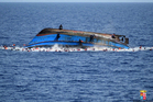 The Italian navy says it has recovered 7 bodies from the overturned migrant ship off the coast of Libya. Photo / AP
