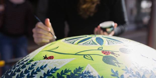 Millie Newitt painting a rubbish bin on Willow St last weekend. Photo/Dane Scott