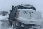 The latest rescue attempts for the group of 4WD adventurers stuck in their vehicles in heavy snow since yesterday and Jimmy Kimmel reunites the stars of Breaking Bad with a 'My Sweet 60th' birthday party for Bryan Cranston.