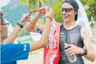Lewis Ryan being presented with his gold medal at the Xterra Malaysia triathlon.