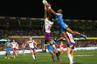 Suliasi Vunivalu of the Storm and Semi Radradra of the Eels compete for the ball. Photo / Getty