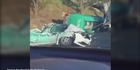 One killed, six injured after tanker rolls on cars in rush hour traffic