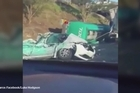 Six people are in hospital and one may have died after a petrol tanker rolled, crushing a car and starting a chain of collisions on a Melbourne motorway.