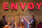 Employees of Envoy can be seen working in their San Francisco office space. The 30-person company enables businesses to register visitors using iPads instead of handwritten visitor logs. MUST CREDIT: