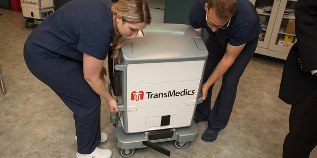 Two technicians carry the Transmedics Organ Care System at Transmedics in Massachusetts. Photo / Washington Post