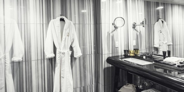Every guest room and suite inside the Watergate Hotel has a spa-like marble bathrooms with custom La Bottega amenities. Photo / The Watergate Hotel