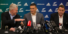 New Zealand Rugby CEO Steve Tew congratulates Sonny Bill Williams as Steve Hansen looks on. Photo / Brett Phibbs