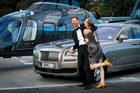 Greg Bruce and his wife Zanna toss up between the Heletranz chopper and the Rolls-Royce Ghost.