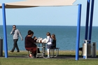 There's nothing like a sunny day on Napier's Marine Parade to bring out the family and for enjoying fish and chips beneath a shade cloth, as yesterday's temperature hovered near the 21C maximum for the city for the day. Photo / Duncan Brown