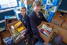 Noah Witheford and Jack Jansen, Tauranga Boys' College students, helping with the food collection. Photo / George Novak