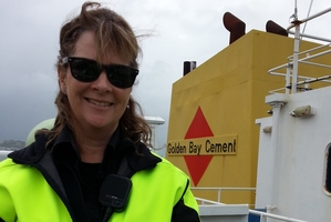Mount Maunganui mother of three Maree Turner at the helm of MV Golden Bay.