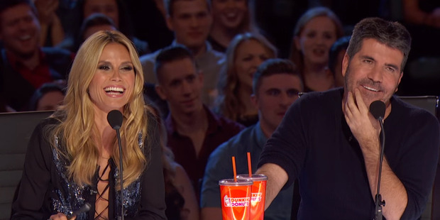 The Boy With Tape On His Face eventually got a smile out of judges Heidi Klum and Simon Cowell.