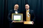 Waipapa Pine head Shane Horan (right) gets his company's awards from Maori Development Minister Te Ururoa Flavell. Photo / C Horsford Photography