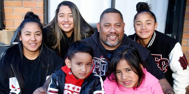 BACK HOME: Frank Kokiri Rota surrounded by his five children at their Hikurangi home yesterday.PHOTO/JOHN STONE