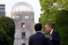 HISTORIC: US President Barack Obama (right) and Japanese Prime Minister Shinzo Abe speak on Friday with the Atomic Bomb Dome in the background at the Hiroshima Peace Memorial Park in Hiroshima, western Japan.PHOTO/APCAROLYN KASTER