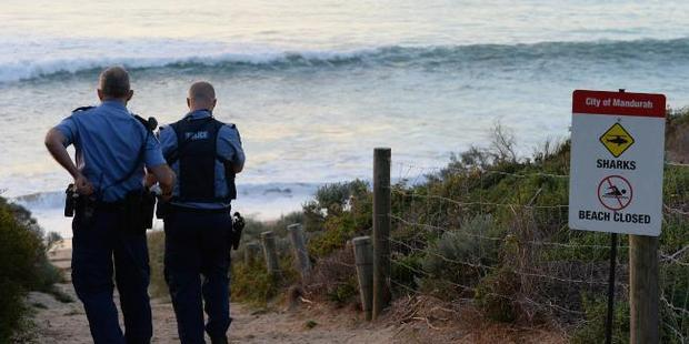 WA police officers at the beach where a surfer was attacked by a shark. Photo / News Corp Australia