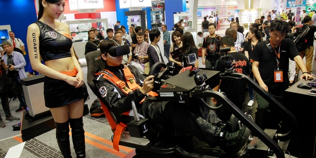 Video game enthusiasts got a taste of virtual reality in Taipei this week, but experts say the technology has a range of uses. Photo / AP
