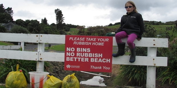 The message is pretty clear but after a clean-up of Urquharts Bay , 9-year-old Jasmine  isn't sure people are listening. Photo / Anita Hollis
