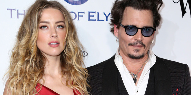 Amber Heard with her husband, Johnny Depp. She has filed for divorce, alleging abuse. Photo/AP
