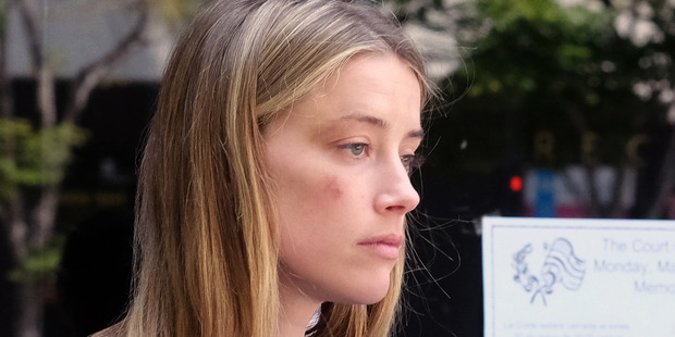 Loading Actress Amber Heard leaves Los Angeles Superior Court after giving a sworn declaration that her husband Johnny Depp threw her cellphone at her. Photo / AP