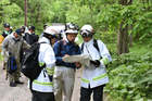 Rescuers search for the 7-year-old boy who is missing in a Japanese forest in Nanae town, on Hokkaido. Photo / AP