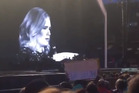 British singer Adele slammed a fan during her concert for filming the show. Photo / YouTube