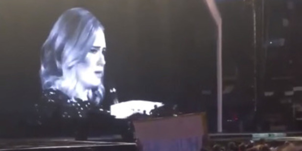 Loading British singer Adele slammed a fan during her concert for filming the show. Photo / YouTube