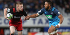 Johnny McNicholl of the Crusaders is tackled by George Moala of the Blues. Photo / Getty Images.