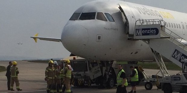The tow truck was photographed crushed under the plane's nose. Photo / @OxBlueBilly, Twitter