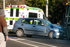 Car and a rubbish truck were involved in a collision on Sunset Rd this morning.  Photo/Ben Fraser