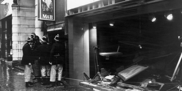 22nd November 1974: Firemen survey the damage outside the Birmingham pub, 'Tavern in the Town', after an IRA bomb blast. Photo / Getty