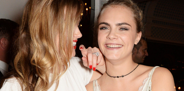 Amber Heard and Cara Delevingne. A source claims they were more than just good friends. Photo/Getty
