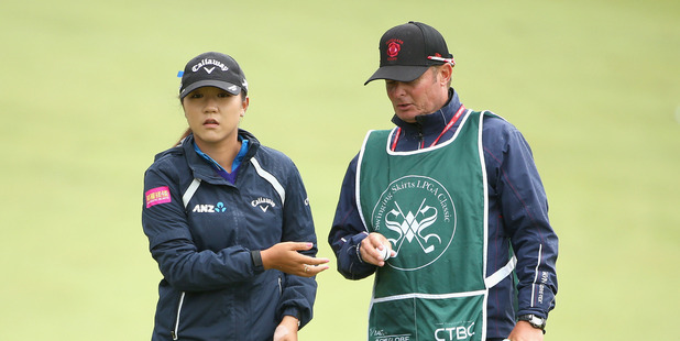 Lydia Ko gets her ball from her caddie, Jason Hamilton, during the Swinging Skirts Classic. Photo / Getty Images