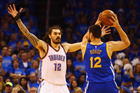 Steven Adams defends Andrew Bogut during game six. Photo / Getty Images