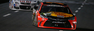 Martin Truex Jr leads a pack of cars during the NASCAR Sprint Cup Series Coca-Cola 600. Photo / Getty Images