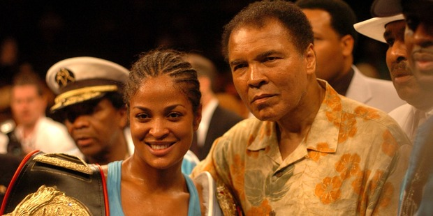 Muhammad Ali with his victorious daughter Laila. Photo / Getty Images