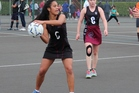 Capri Paekau at centre for Hamilton Girls' High School's 10B team gets ready to pass the ball.