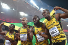 The Jamaican relay team (L-R) Nesta Carter, Asafa Powell, Nickel Ashmeade and Usain Bolt. Photo / Getty Images.