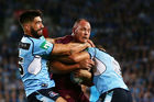 Matt Scott of the Maroons is caught high during game one of the State Of Origin series between the New South Wales Blues and the Queensland Maroons. Photo / Getty