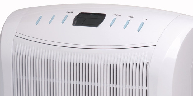 The affected 2013 model - Nouveau 16L electronic dehumidifier (Model NH-DB16E) - carries both this model number and the date code 0213.