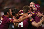 Cameron Smith, Aidan Guerra, Michael Morgan, Darius Boyd and Johnathan Thurston of the Maroons celebrate after Morgan scores a try. Photo / Getty