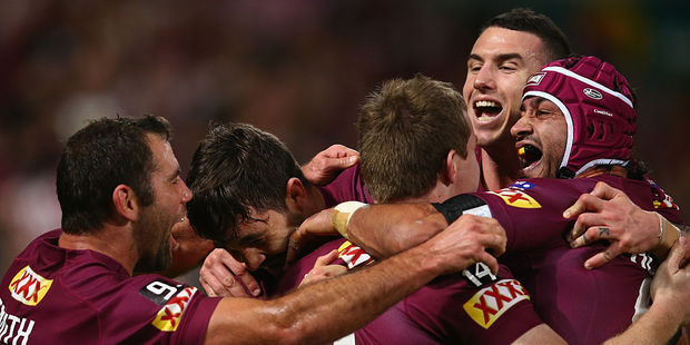 Loading Cameron Smith, Aidan Guerra, Michael Morgan, Darius Boyd and Johnathan Thurston of the Maroons celebrate after Morgan scores a try. Photo / Getty