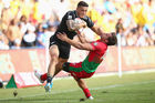 Sonny Bill Williams bumps out of the tackle from Tiago Fernandes of Portugal during the 2016 Sydney Sevens. Photo / Getty Images