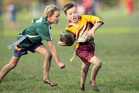 Ngongotaha player Noah Fisher, 8, with ball, and Reporoa player Tyler Phillips, 9. Photograph by Ben Fraser.